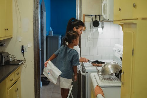 Mother and daughter cooking in kitchen