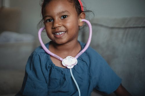 Cheerful Asian girl with stethoscope