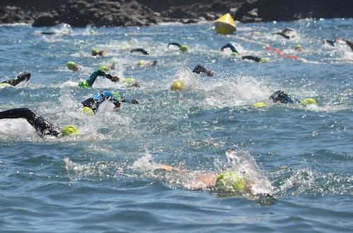 People Swimming on Sea Water