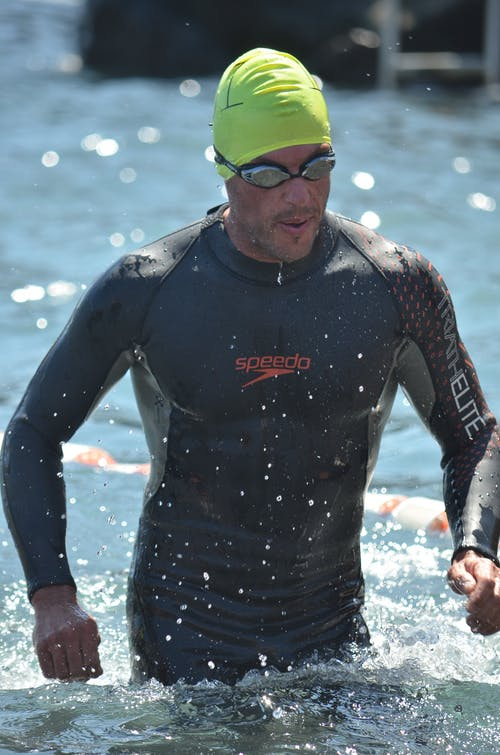 A Man in Swimwear Rising Off the Sea Water