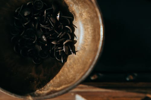 Black Coffee Beans in Brown Round Container