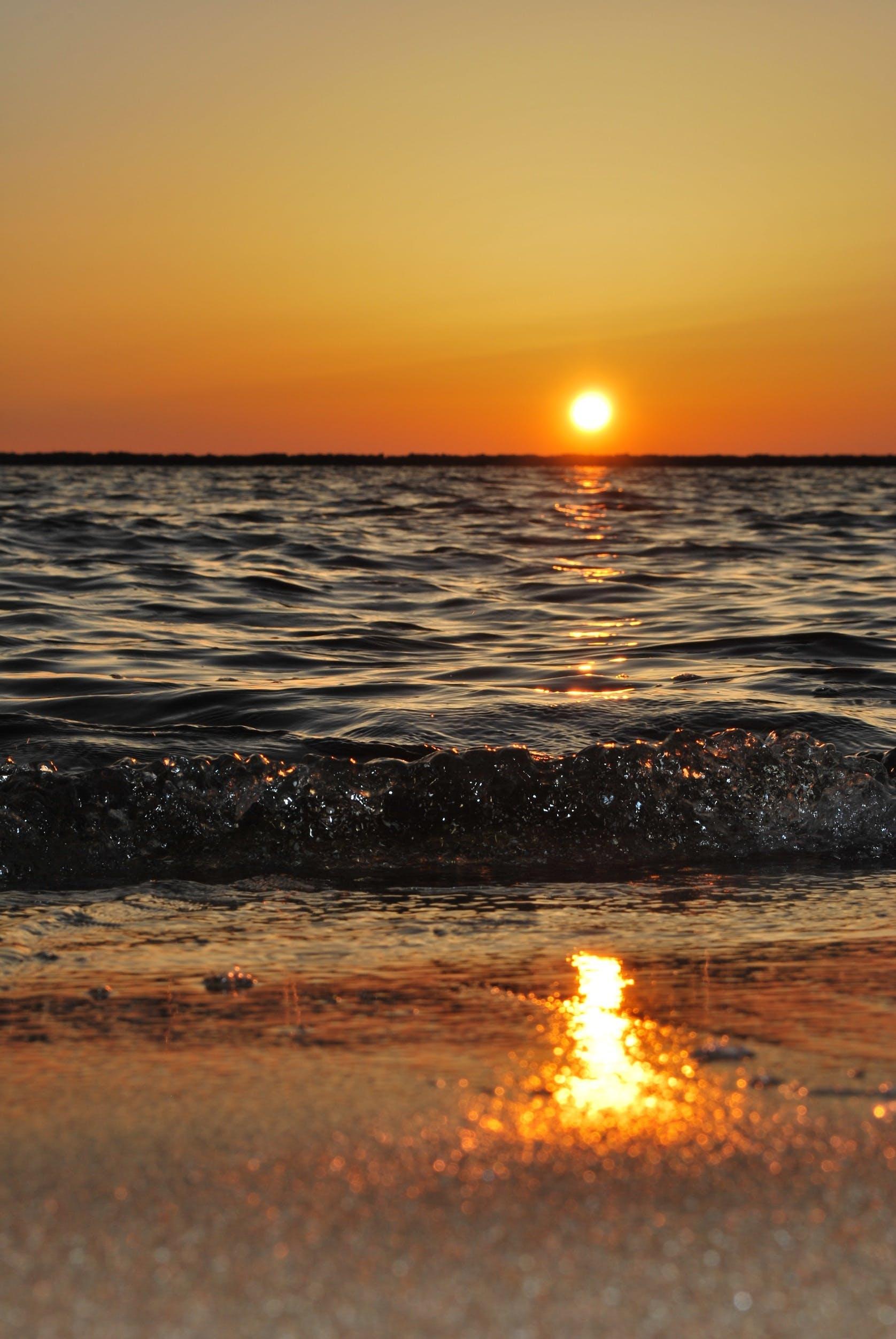 Free stock photo of sunset, beach, sand, water