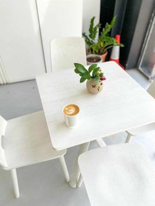 White Ceramic Mug on White Wooden Table