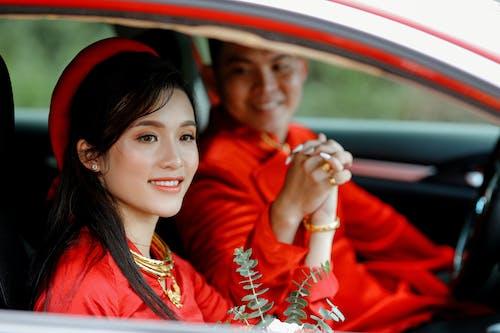 Happy Asian women smiling in car