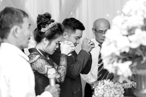 Sensual Asian newlyweds in wedding hall