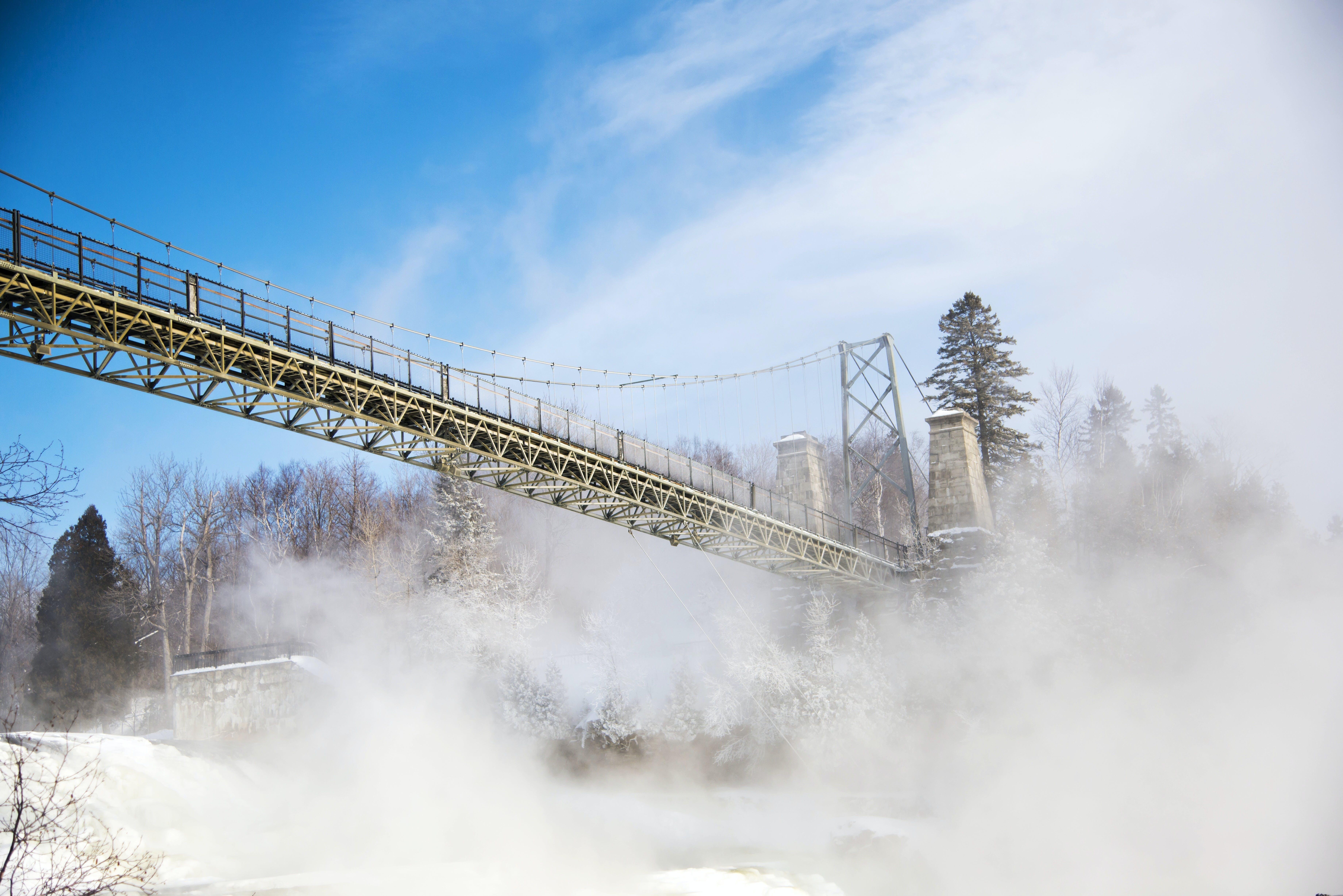Smokes Under Bridge during Daytime
