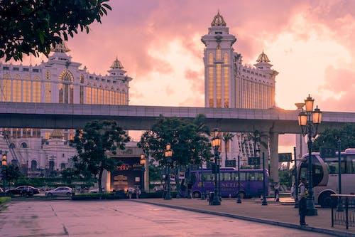 Бесплатное стоковое фото с автобусы, архитектура, восход, город