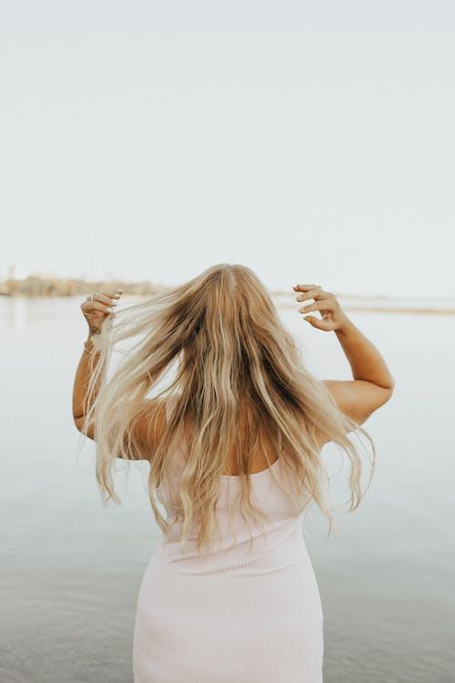 Woman on beach near calm sea