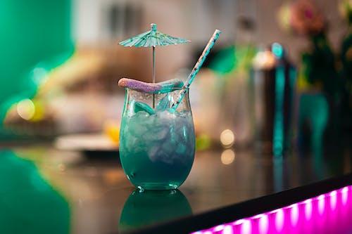 Blue Glass Vase With Blue Liquid