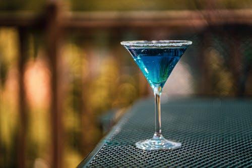 Close-Up Shot of a Glass of Blue Martini