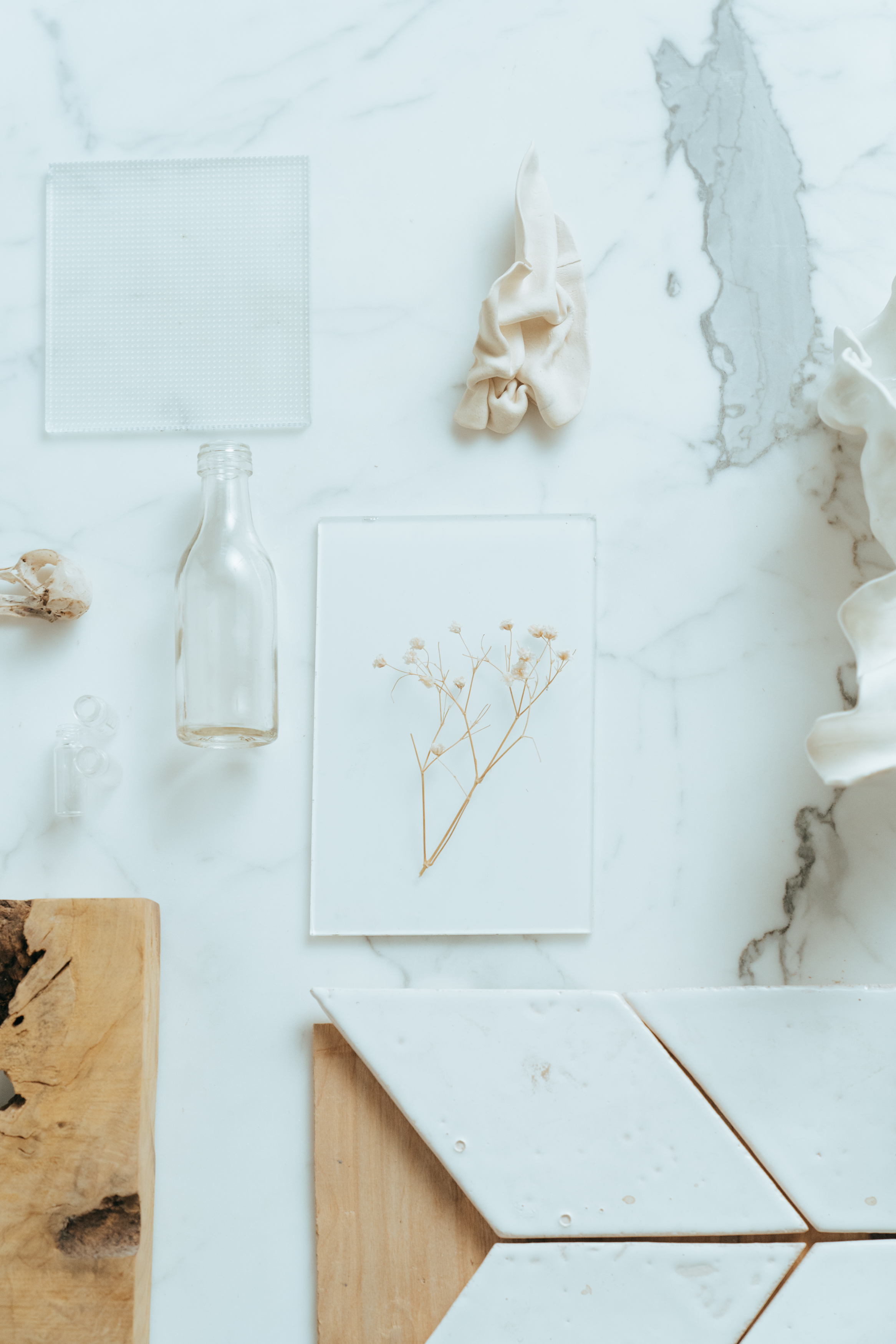 white ceramic angel figurine on white wooden table