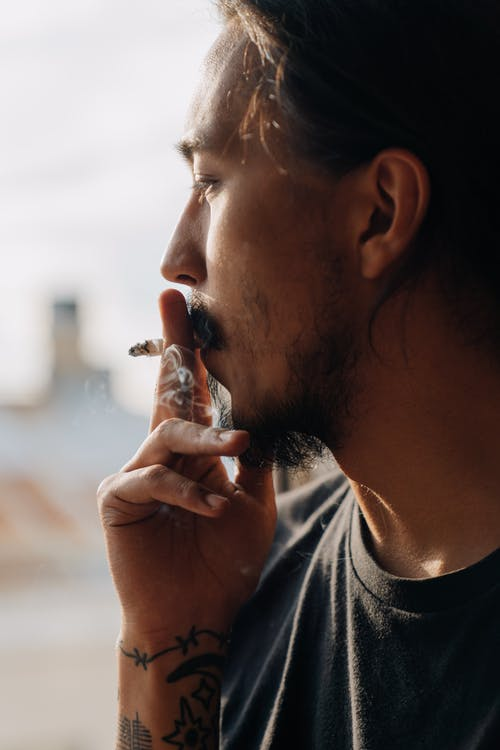 Side View of a Man Smoking a Cigarette