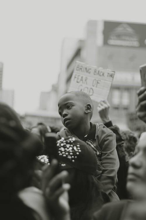 Black child on protest on street