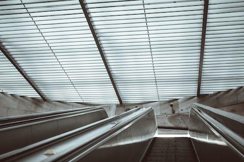Escalator in modern subway station entrance