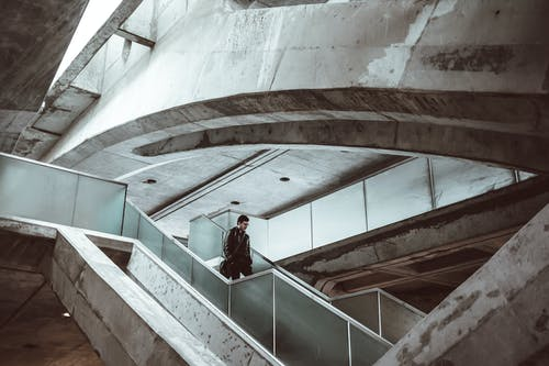 Man on stairs in concrete futuristic building