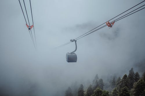Cableway in clouds in overcast weather