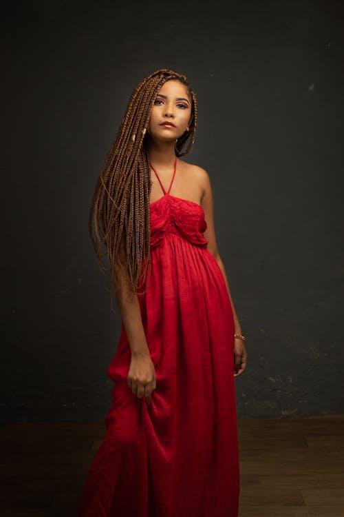 Elegant woman in red dress in studio