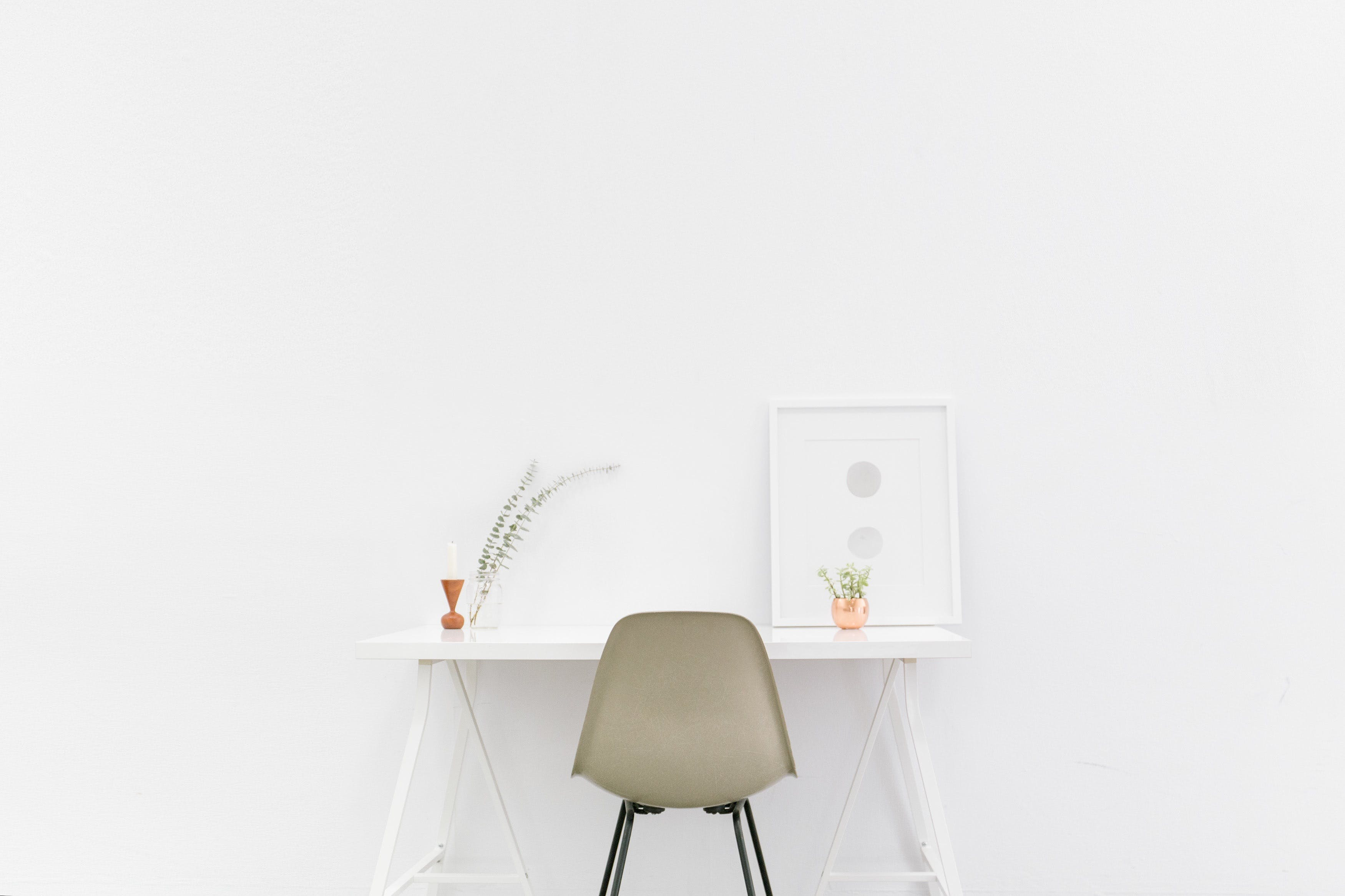 Beige and Black Chair in Front of White Desk