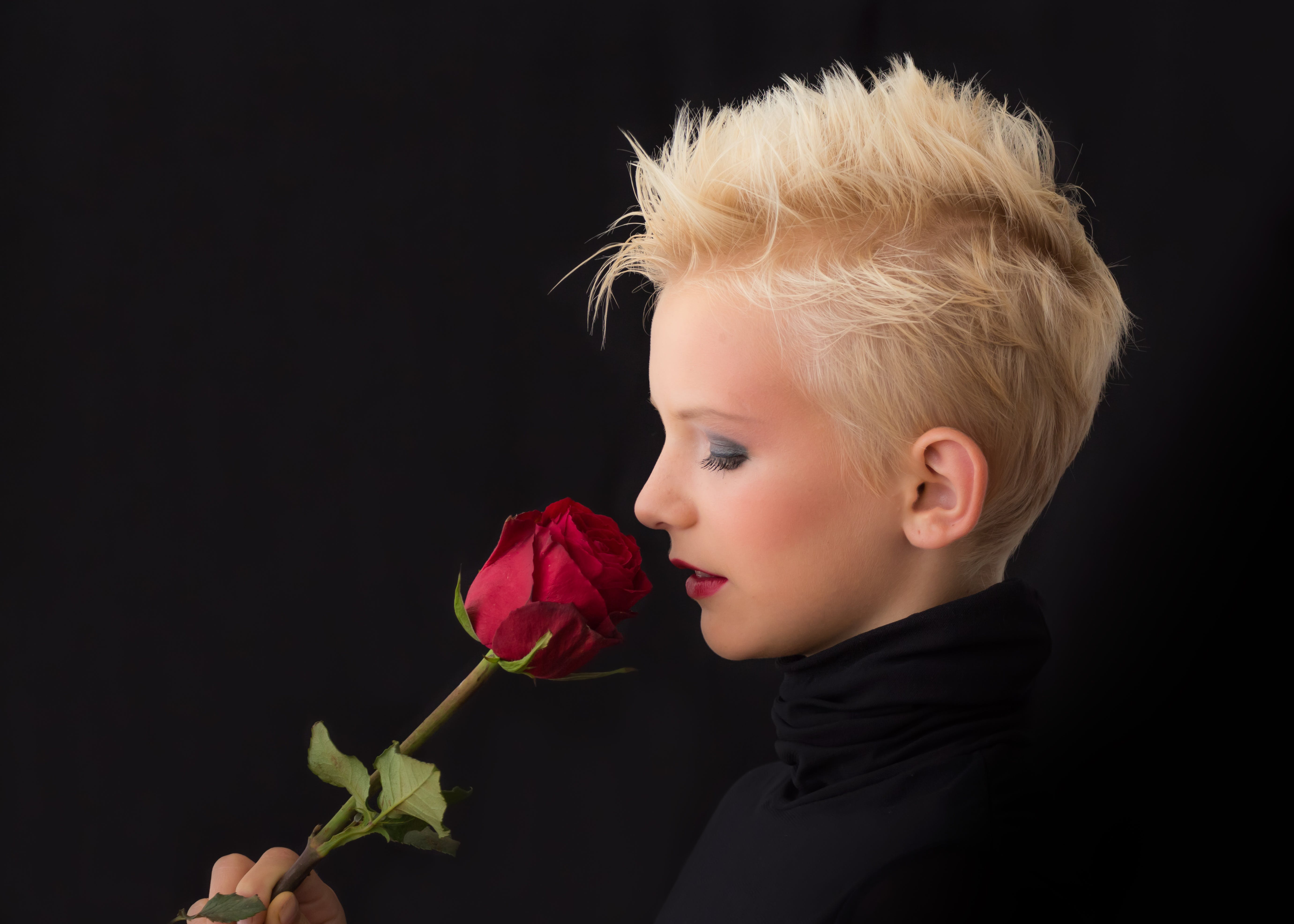 Woman Holding Red Rose