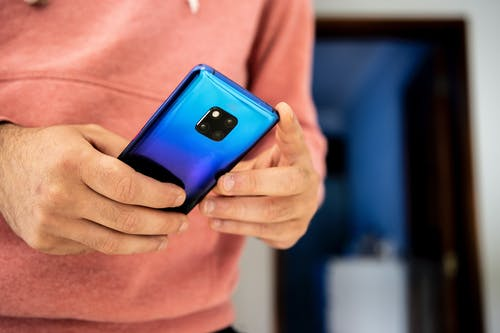 Person Holding a Blue Smartphone