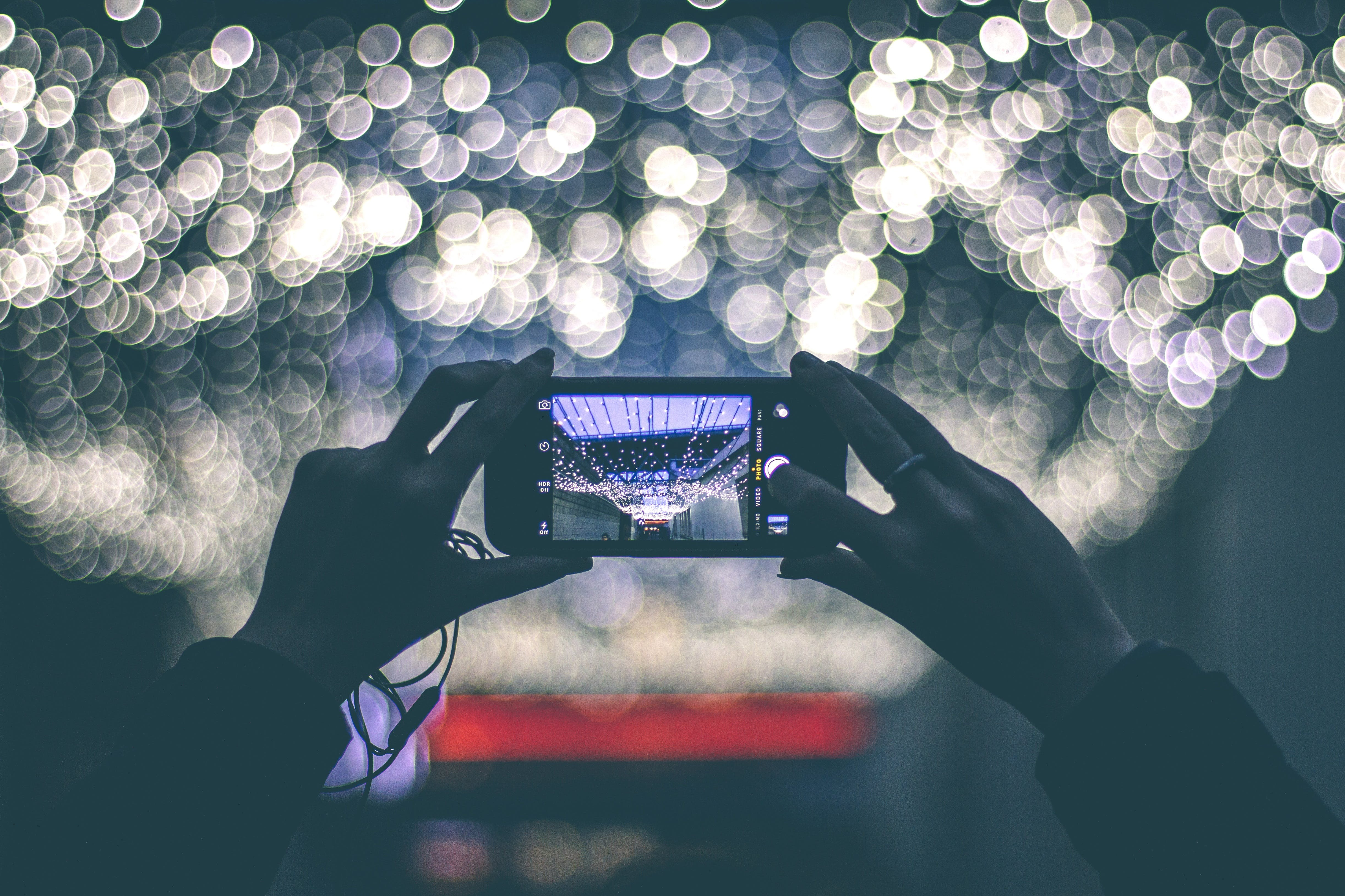 Free stock photo of hands, lights, camera, smartphone