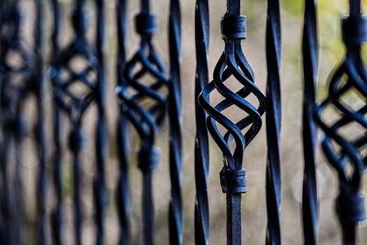 Black Steel Fence during Daytime