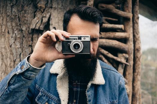 Free stock photo of man, person, camera, taking photo