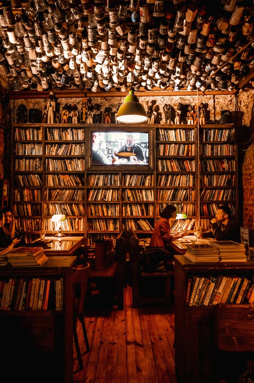 Interior of cozy cafe with bookshelves