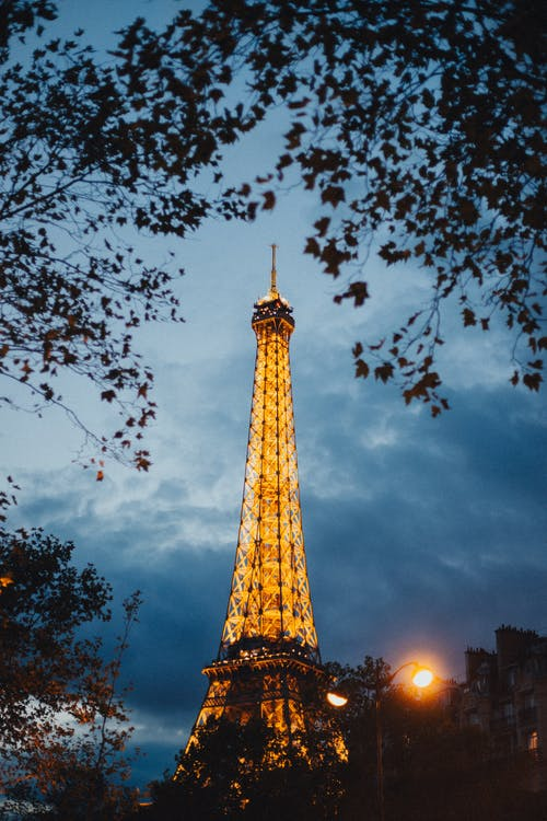 Eiffel Tower Under Cloudy Sky during Night Time