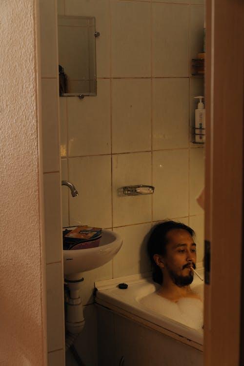 Man in Bathtub With Cigarette