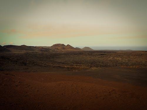 Amazing wild desert terrain with mountains at sundown