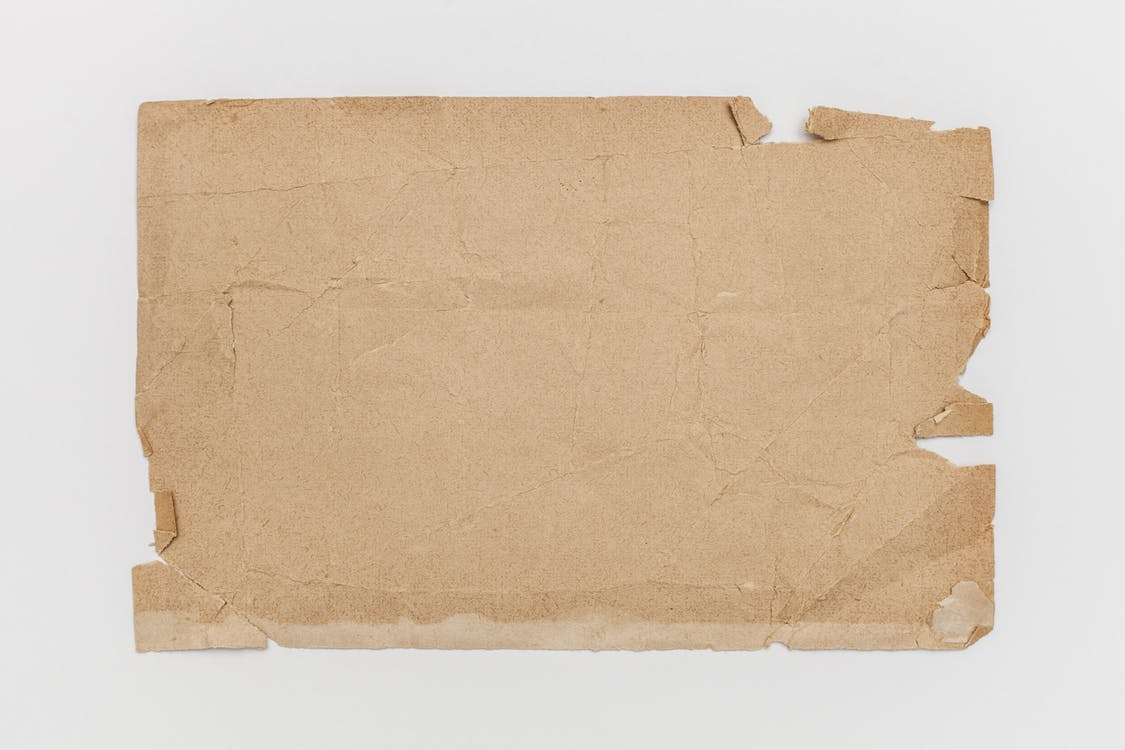 Brown Crumpled Paper Bag On Table