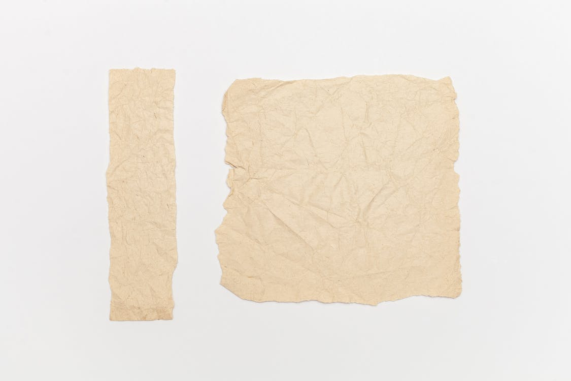 Brown Crumpled Paper On White Background
