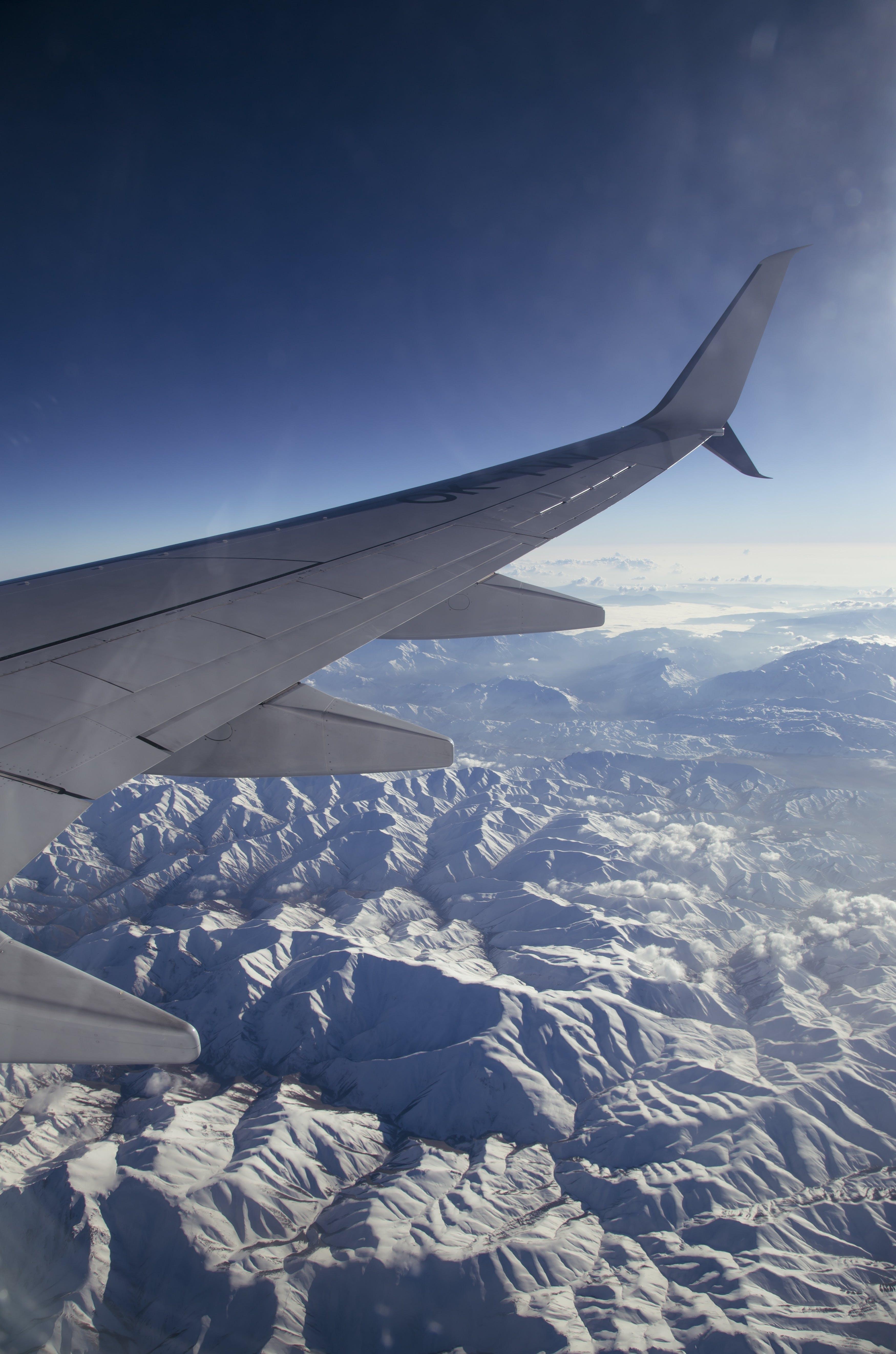 Free stock photo of snow, flight, mountains, sky