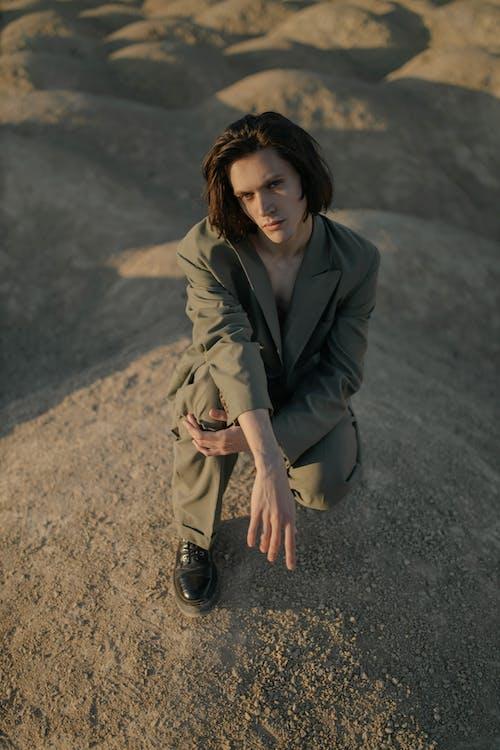 Woman in Black Coat Standing on Gray Asphalt Road