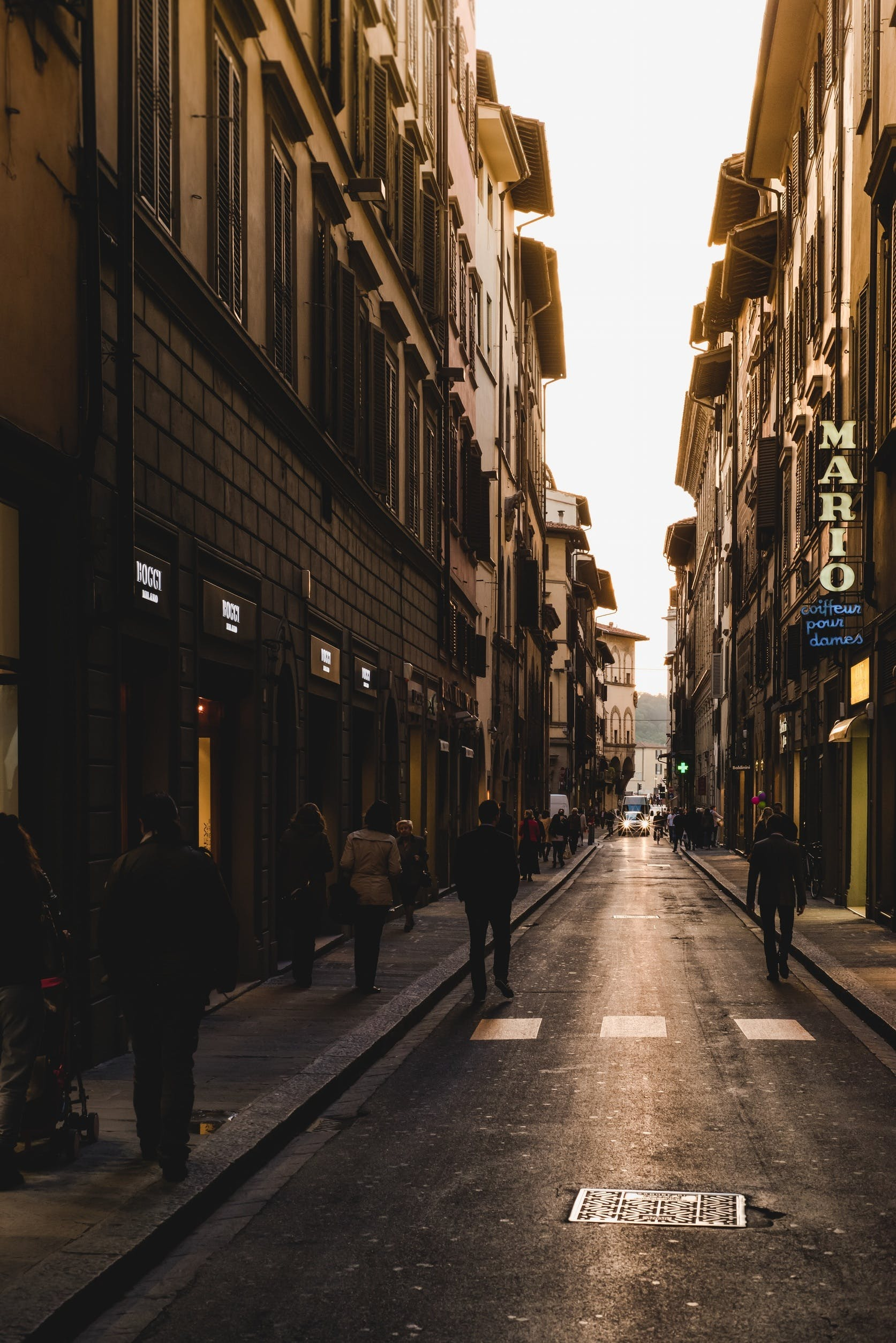 Person Walking on Street during Daytime