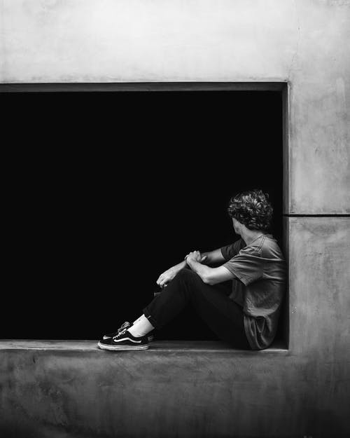 Anonymous stylish guy resting on street