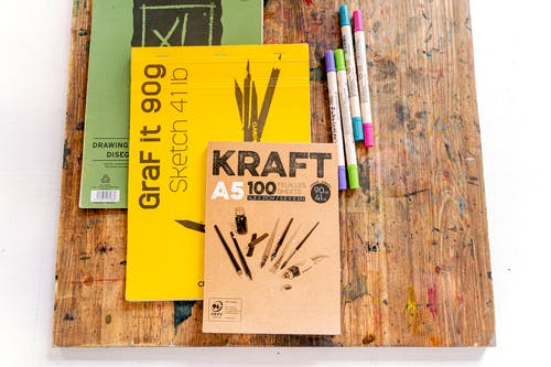 Color Pencil Set on Brown Wooden Table