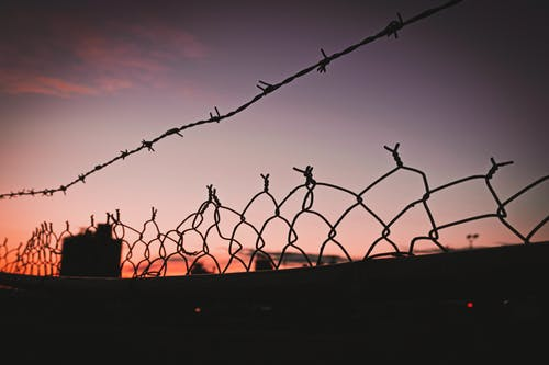 Silhouette of Metal Fence during Sunset
