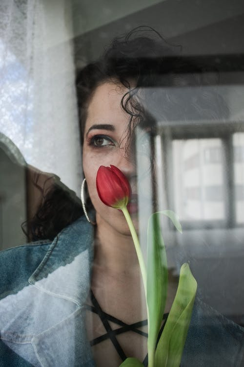 Charming woman with red tulip