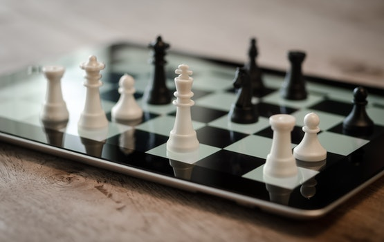 Tilt Shift Lens Photo of Black and White Chess Pieces