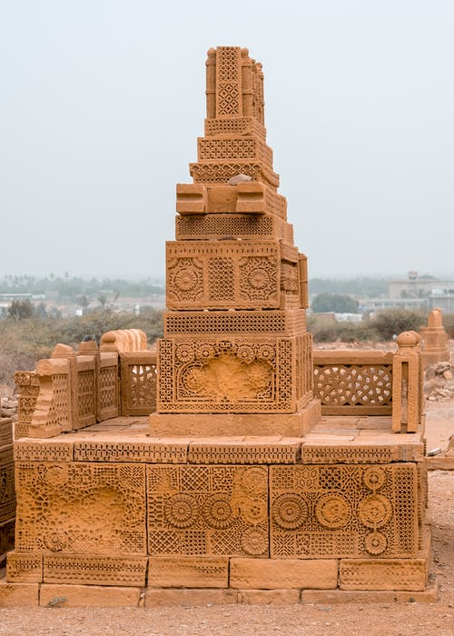 Sandstone weathered ancient park of Chaukhandi tombs with carved fence and ornamental patterns located in Sindh province of Pakistan on cloudy day