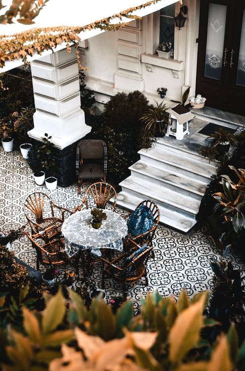 Cozy terrace with round table near house