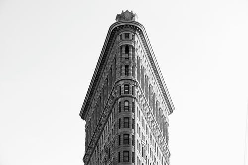 Greyscale Photo Of Flatiron Building