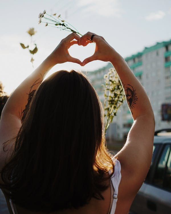 Photo Of Woman Doing Heart Shaped Hand Gestures