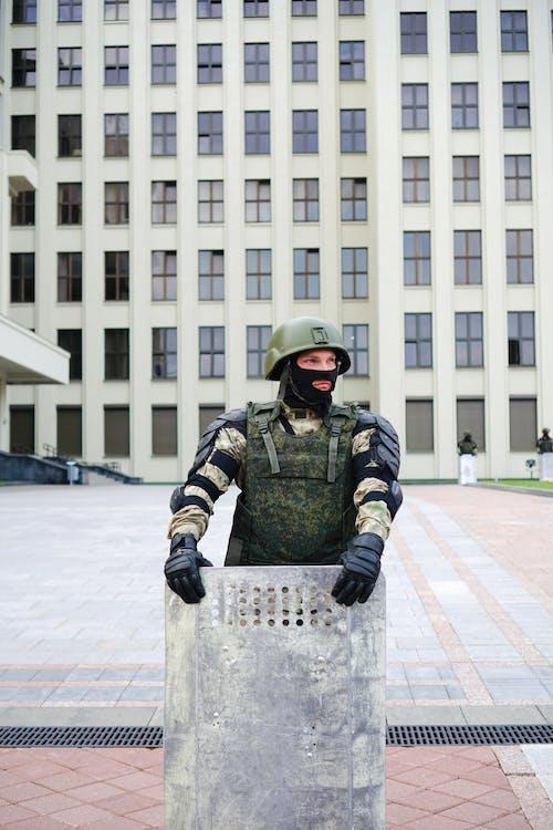 Policeman Holding Shield
