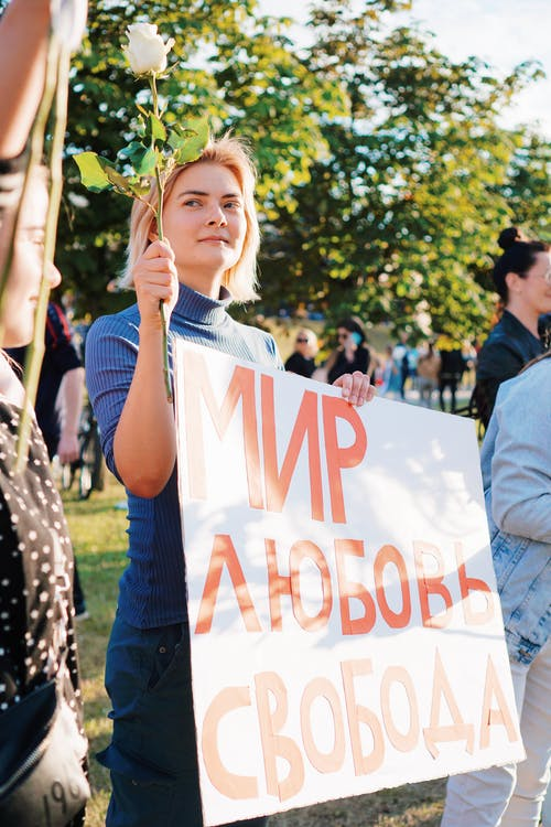 Woman Holding Sign at Protest