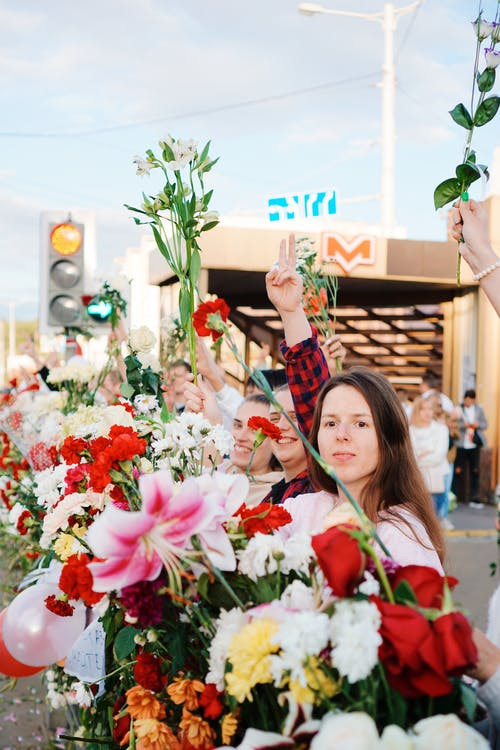Protesters Holding Flowers