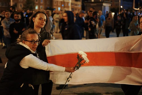 Protesters Holding Flowers and Flag