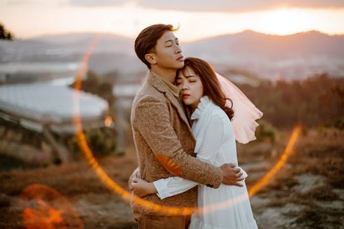 Romantic ethnic couple embracing in evening time
